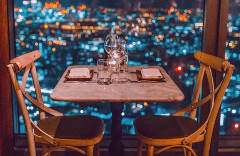 Empty restaurant table for two at nighttime