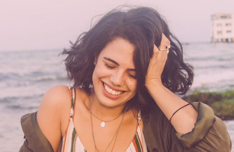 Woman laughing about dating problems with men