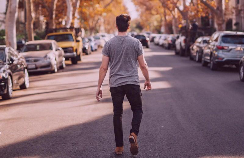 Emotionally unavailable man walking away