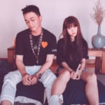 sad bored asian couple sitting bed